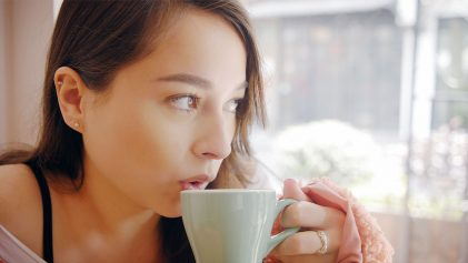Lou drinking coffee | Shanghai's Best Cafés | The ChinaTravel Video | ANYDOKO
